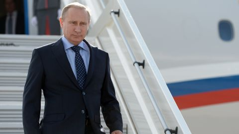 """Russia's President Vladimir descends from his plane while arriving in the Volga River city of Samara 868 km (539 miles) southeast of Moscow, on July 21, 2014. US President Barack Obama said yesterday that Putin must prove """"that he supports a full and fair investigation"""" of the Malaysian plane disaster. AFP PHOTO / RIA-NOVOSTI / POOL/ ALEXEI NIKOLSKYALEXEI NIKOLSKY/AFP/Getty Images"""