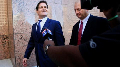 Cuban exits federal court in Dallas on September 30, 2013, during a trial over regulators' claims he engaged in insider trading when he sold his stake in a Canadian Internet search company. The jury acquitted him of the charge, handing a defeat to the government.