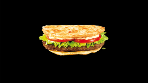 """This ground beef sandwich with onions, cumin, and coriander is marketed as the McArabia sandwich in Morocco. According to McDonald's Morocco, it contains """"a thousand and one flavors"""" that """"wake up our taste buds."""""""