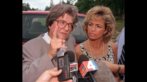 Prejean speaks to the media after Lori Urs, right, married Joseph O'Dell just hours before his execution in Virginia in 1997. Prejean believes O'Dell was innocent, too.