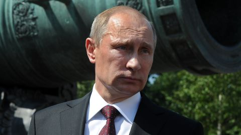 Russia's President Vladimir Putin stands in front of the 6 meters long Tsar Pushka (Tsar Cannon), one of the Russian landmarks displayed in the Kremlin in Moscow, on July 31, 2014. A defiant Russia said yesterday that Western sanctions over Ukraine would backfire on the United States and lead to energy price hikes in Europe after Brussels and Washington unveiled the toughest punitive measures against Moscow since the Cold War.