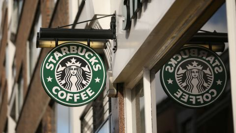 Starbucks CEO Howard Schultz says the coffee chain will roll out a delivery option in the latter half of 2015.