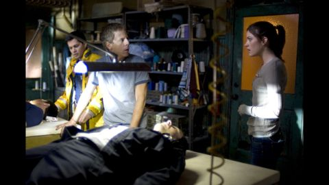 """A small TV crew gets trapped in a quarantined area after an unknown infection is discovered in the 2008 movie """"Quarantine."""" An intentional introduction of a mutated rabies virus is behind the outbreak and turns the infected into violent killers."""