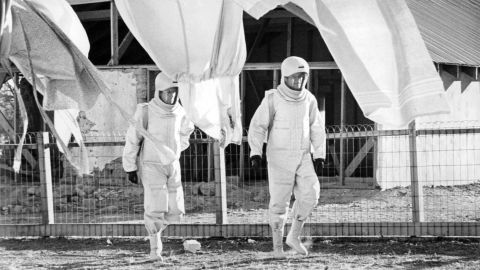 """A virus begins killing people in New Mexico after a satellite falls to Earth in the 1971 movie """"The Andromeda Strain."""" Scientists in an isolated lab study the virus, which dangerously mutates before becoming benign."""