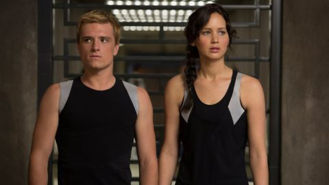 """<strong>""""The Hunger Games"""":</strong> Suzanne Collins' trilogy is set in Panem, a totalitarian U.S. successor. The Hunger Games are an annual competition in which adolescents from its 12 regions compete to the death to entertain the populace. The movies star Jennifer Lawrence (right, with Josh Hutcherson) in the lead role as Katniss Everdeen, whose cleverness and skills soon prove a threat to the ruling order."""