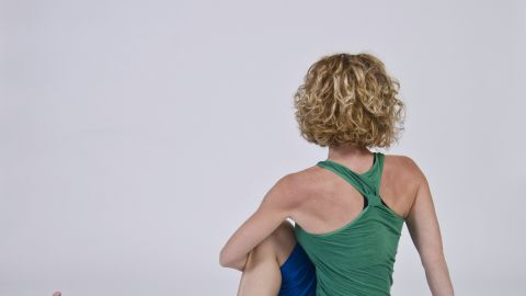 This mid-back rotating twist stretches the piriformis. Use caution because incorrect twisting from your low back could exacerbate disc issues.