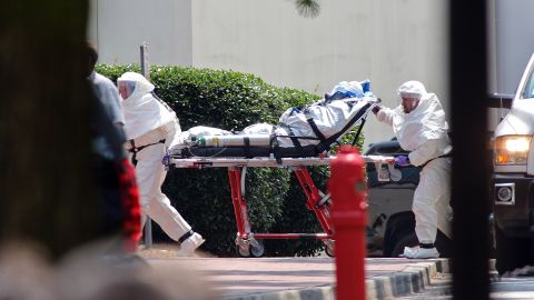 Aid worker Nancy Writebol, wearing a protective suit, gets wheeled on a gurney into Emory University Hospital in Atlanta on August 5, 2014. A medical plane flew Writebol from Liberia to the United States after she and her colleague Dr. Kent Brantly were infected with the Ebola virus in the West African country.