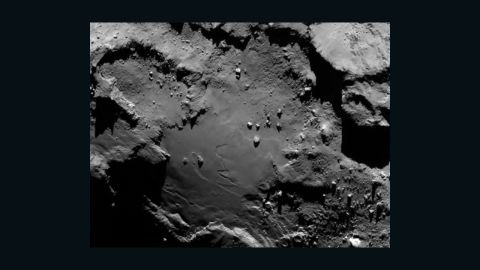 """The spacecraft sent this image as it approached the comet on August 6, 2014. From a distance of nearly 81 miles (130 kilometers), it reveals detail of the smooth region on the comet's """"body"""" section."""