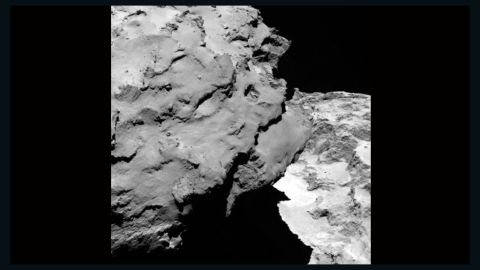 """The comet's """"head"""" can be seen in the left of the frame as it casts a shadow over the """"body"""" in this image released August 6, 2014."""