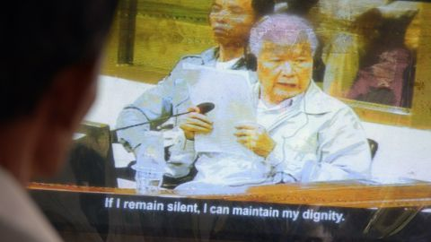 A Cambodian man Khieu Samphan on a television during the trial at the Extraordinary Chamber in the Courts of Cambodia (ECCC) in Phnom Penh on August 7. He and Nuon Chea were found guilty of crimes against humanity and sentenced to life in prison.