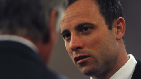 Pistorius speaks to someone in court as his murder trial resumes in Pretoria on Thursday, August 7.