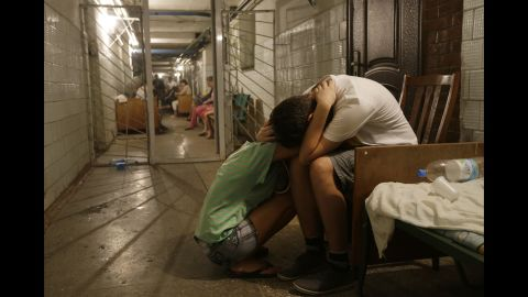 Residents of eastern Ukraine cry in a hospital basement being used as a bomb shelter August 7 in Donetsk.