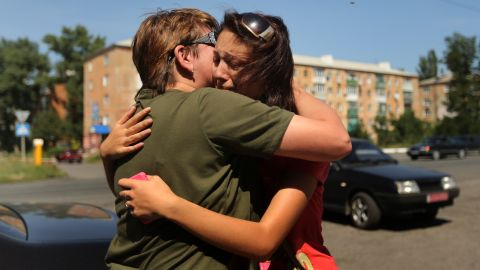 """A woman says goodbye to her mother as she flees her home in Shakhtersk, Ukraine, on Tuesday, July 29. <a href=""""http://www.cnn.com/2014/05/27/world/gallery/ukraine-after-election/index.html"""">See more photos of the crisis from earlier this year</a>"""