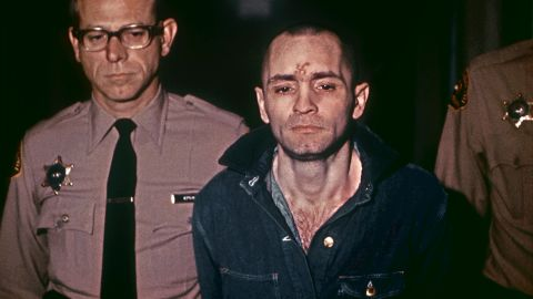 Manson, head shaved and beardless, is led his sentencing hearing on March 29, 1971. He received the death penalty as well.
