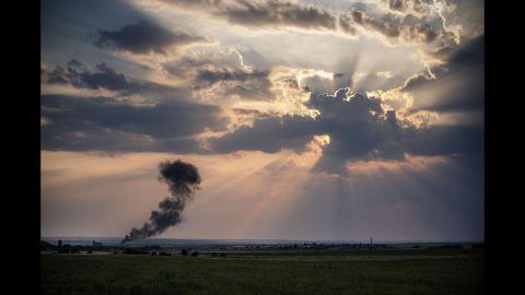 Smoke billows from a Ukrainian fighter jet crash near the village of Zhdanivka, Ukraine, on August 7.