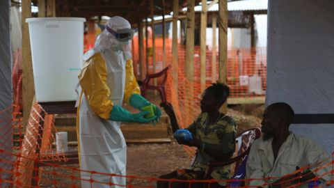 Lassa fever in the same family of viruses as the Ebola virus. Both diseases can cause haemorrhaging and can spread through contact with infected bodily fluids, though this is more rare with Lassa fever. Pictured, a healthworker gives food to confirmed Ebola patients.