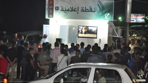 A video is shown to residents at an ISIS propaganda information center in Mosul, Iraq.