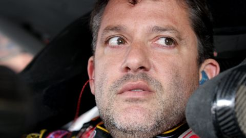 Caption:WATKINS GLEN, NY - AUGUST 08: Tony Stewart, driver of the #14 Rush Truck Centers/Mobil 1 Chevrolet, sits in his car during practice for the NASCAR Sprint Cup Series Cheez-It 355 at Watkins Glen International on August 8, 2014 in Watkins Glen, New York. (Photo by Jerry Markland/Getty Images)