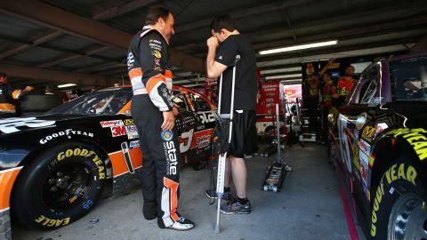 Driver Ryan Newman talks with Stewart in September 2013. Stewart broke his leg a month earlier during a race in Oskaloosa, Iowa.
