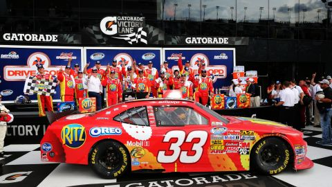 Stewart poses after winning a race in Daytona in February 2013.