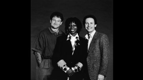 """Robin Williams was honored during 2014's Emmy telecast with a tribute led by friend Billy Crystal, who hosted the """"Comic Relief"""" benefits with Williams and Whoopi Goldberg (seen here in 1986)."""