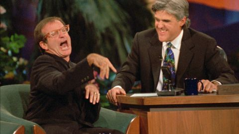 """Jay Leno laughs as Williams jokes around during a taping of """"The Tonight Show with Jay Leno"""" on November 13, 1995, at the MGM Grand Hotel in Las Vegas."""