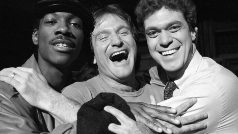 """Williams, center, takes time out from rehearsal at NBC's """"Saturday Night Live"""" with cast members Eddie Murphy, left, and Joe Piscopo on February 10, 1984. Williams would appear as guest host on the show."""