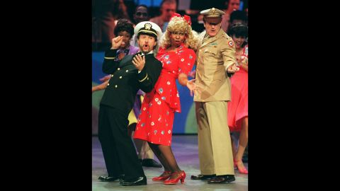 """Comedians and co-hosts, from left, Billy Crystal, Whoopi Goldberg and Williams sing and dance the 1940s-era opening number to """"Comic Relief VII"""" on November 11, 1995, in Los Angeles."""