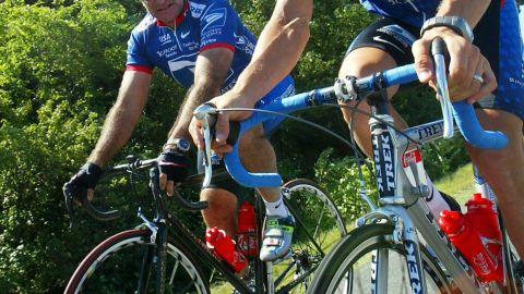 Williams shares a moment with Armstrong during a rest day at the 2002 Tour de France. The pair were personal friends.