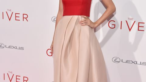 """Taylor Swift wearas her signature """"Red"""" on the carpet at the New York City premiere of """"The Giver."""""""