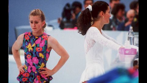 """Tonya Harding, the first female figure skater to complete a triple axel in competition, received a lifetime ban from U.S. Figure Skating after her ex-husband attacked rival skater Nancy Kerrigan before the 1994 Winter Olympics. The U.S. federation concluded that Harding, seen here at left next to Kerrigan, knew about the attack beforehand and engaged in """"unethical behavior."""""""