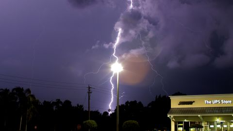 """It's only an optical illusion, but lightning appears to be striking a lamppost in this June photo from <a href=""""http://ireport.cnn.com/docs/DOC-1141887"""">Billy Ocker</a>. """"The storm was wicked strong,"""" he remembered."""