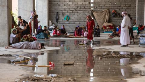 Aug 14, 2014, Iraq, Kurdistan, Zakho. A Yazidi family from Sinjar  cleaning a spot for themselves  in a derelict building that houses more than a thousand other refugees. Photo by Warzer Jaff for CNN
