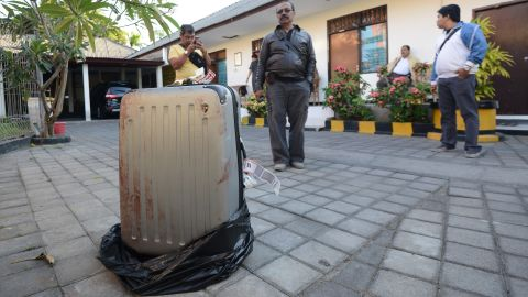 The body of Sheila von Weise Mack, 62, was stuffed in this hard-sided gray suitcase, displayed here at a police station.