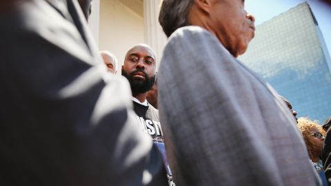 Michael Brown Sr. stands alongside Sharpton, right, during a news conference in St. Louis on August 12, 2014.