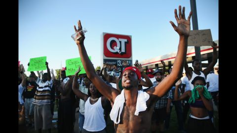 Demonstrators protest August 12 in Ferguson, 2014.