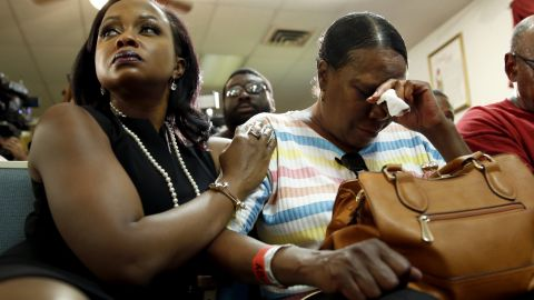 Phaedra Parks, left, comforts Desuirea Harris, the grandmother of Michael Brown, during a news conference in Jennings, Missouri, on August 11, 2014.