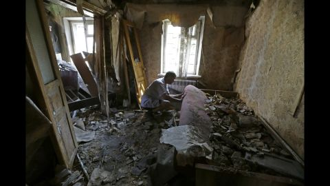A man inspects damage at his house after a shelling in Donetsk on August 14.