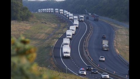 A convoy of trucks, which Moscow said was carrying relief goods for war-weary civilians, moves from Voronezh, Russia, toward Rostov-on-Don, Russia, on August 14.