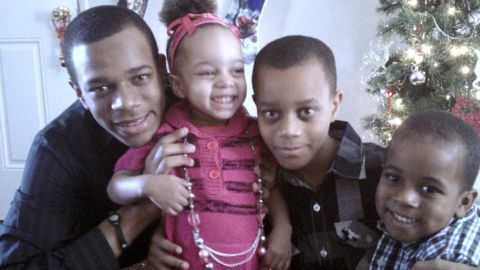 Crishawn Spicer, a 15-year-old high school sophomore (left), with siblings Kaila, 3, Cameron, 12, and Kyle, 5.