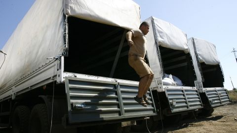 A truck driver from the convoy jumps out of a trailer on August 15. The Ukrainian government had expressed fears that the convoy was a large-scale effort to smuggle supplies or troops to pro-Russian rebels.