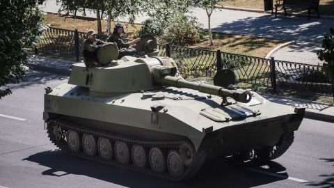 A tank belonging to pro-Russian rebels moves along a street in Donetsk on August 15.