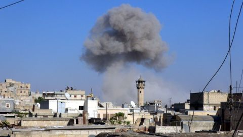 Smoke trails over Aleppo following barrel bombs that were allegedly dropped by the Syrian regime on an opposition-controlled area on Monday, August 11.
