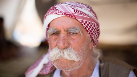 """""""I don't want to live with Arabs anymore. They take our land, they kidnap our woman. And they kill us, why should I live with them?"""" asked a 75-year-old Yazidi named Ali Khalid."""