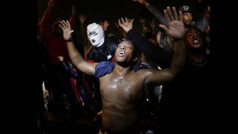 Demonstrators defy a curfew early on August 17, 2014.