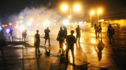 Police fire tear gas at demonstrators after curfew on August 17, 2014.