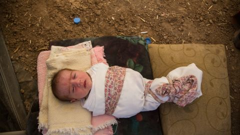 """This 6-day-old girl was born on Sinjar Mountain. Her mother might name her """"Hajar,"""" meaning migrant or as the family interpreted it, """"Exile."""""""