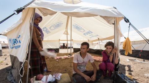 Baby Hafar with her mother, Nariman Barkath, 20; her husband, Khairi Khalaf, 22; and Khairi's little sister.