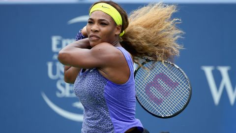 """With her hair -- <a href=""""https://www.cnn.com/2012/08/15/sport/tennis/serena-venus-roddick-williams-tennis/index.html"""" target=""""_blank"""">which she once described as """"super crazy""""</a> -- tied back, Serena blasts a shot in a match against Ana Ivanovic in Cincinnati."""