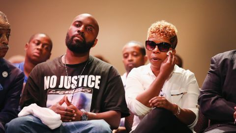 Michael Brown Sr. and Lesley McSpadden, the parents of Michael Brown, attend a rally at Greater Grace Church in Ferguson on August 17, 2014.